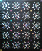 Custom quilt in Amish Stars pattern