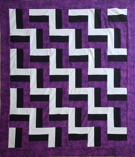 Custom quilt in Purple Rail Fence pattern